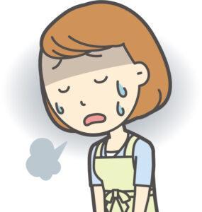 ため息をつく女性保育士